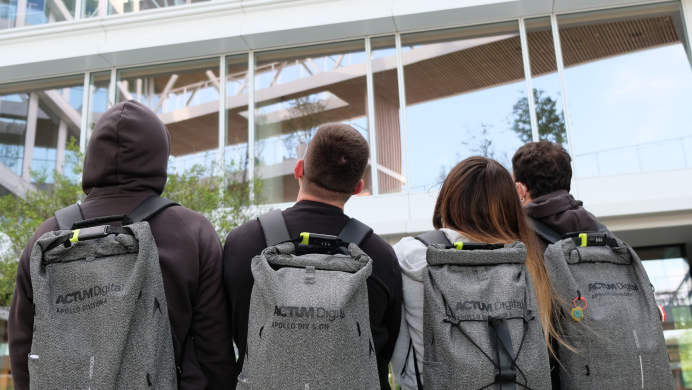 Apollo team in front of the office building with their Apollo Backpacks